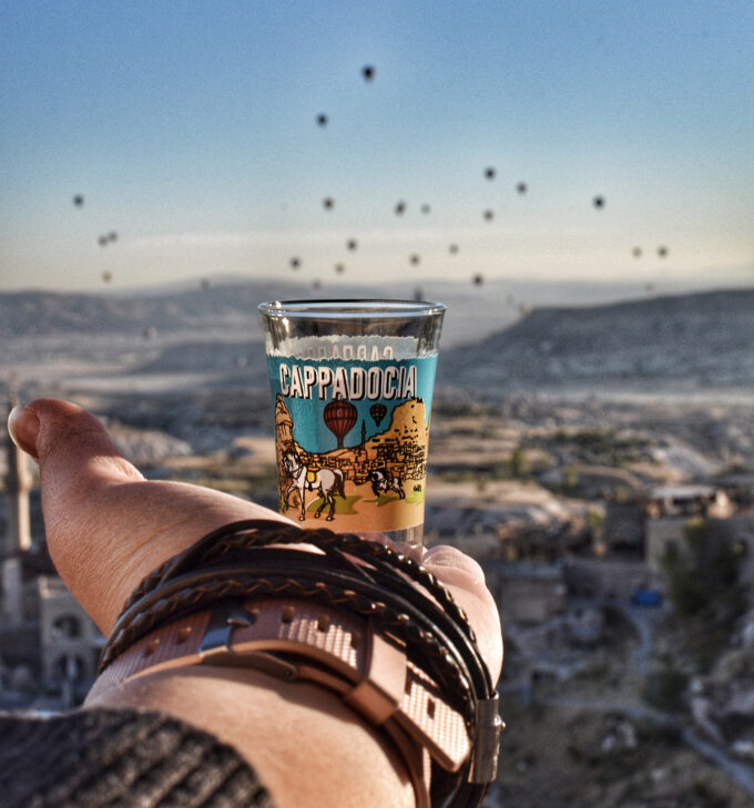 Catching sunrise in Uchisar and watching hot air balloons take off in Cappadocia.