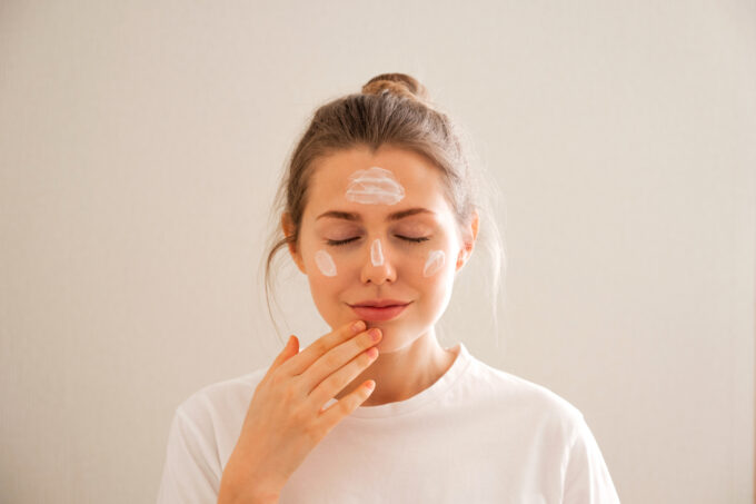 young girl takes care of her face skin.